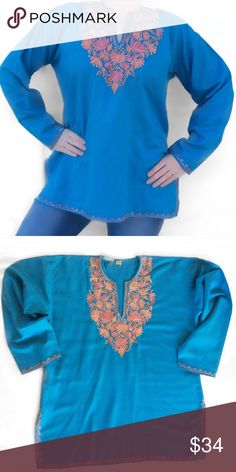 """Teal & Orange Indian Tunic Brand new without tags, never worn. Perfect condition. Super soft & light warm Teal colored Indian Tunic. Beautifully detailed Orange embroidered floral neckline, arm cuff & hem detail. Cordoba Kashmir. Made in India. Labeled a size Medium. I don't agree, it's definitely a Large. Exact measurements: 44"""" Bust. 27"""" Length. 21"""" Arm Length. 8"""" Side Slits. Bundle for a fantastic discount. Also open to offers. Tops Tunics"""