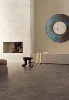 cement floors & fire place Like the color and the simple design.
