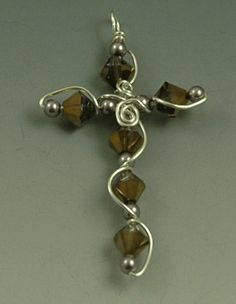 pattern for a bead and wire cross | Using wire wrapping techniques create a bracelet with a cross focal ...