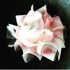 Raw scallops -- hidden under ribbons of kohlrabi, sprinkled with beetroot powder.