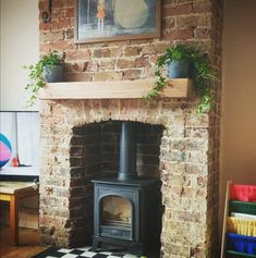 We love seeing pics of our work from our customers. This is an air dried oak mantel installed over a lovely brick fireplace.