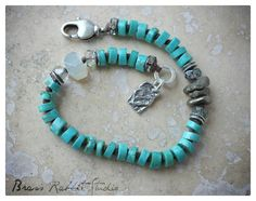 """Petite, genuine turquoise, knotted Stacker with pyrite nuggets and moonstone accents. A sterling silver artisan heart tag hangs near the clasp. This bracelet is perfect Stacker with almost any other Stacker from my shop, fits a 6.25""""-7"""" wrist and can be adjusted. (shown with two other bracelets, sold separate)"""
