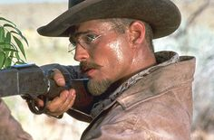 Jason Priestley, who wears corrective glasses in real life, had his character, Billy Breckinridge in Tombstone, wear the period-correct K-Bridge oval spectacle frames with spring-steel curl temples. Tombstone 1993, Tombstone Movie, Old Movies, Vintage Movies, Jason Priestley, Robert Duvall, Val Kilmer, Hero Movie, Cinema Movies