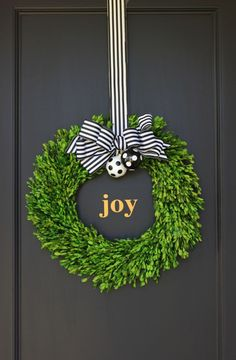Black, gold and white holiday decor! We used a boxwood wreath, black & white striped ribbon and DIY black & white polka ornaments. We added a custom gold Joy decal to finish off the look. By jane can. Christmas Front Doors, Christmas Door Wreaths, Christmas Love, All Things Christmas, Christmas Holidays, Christmas Crafts, Christmas Ideas, Christmas Stairs, Christmas Greenery