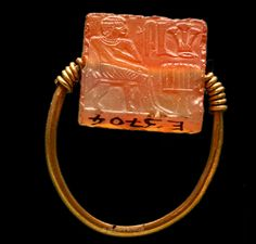 Gold Ring with Carnelian A figure before an altar, above the name Ha-ro-bes. The…