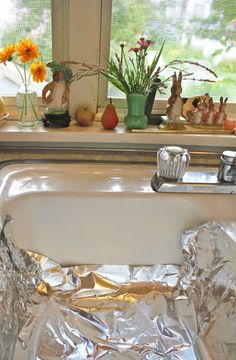 Cleaning Silver I lined the sink with aluminum foil, the bottom and up on all sides. Then I poured a half-cup of ordinary table salt and a half-cup of baking soda into the sink; filled it with really hot water, and dropped in the silverware. Leave in water for half hour