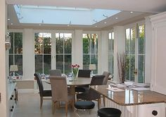 Orangery near Twickenham and Richmond extends the kitchen and family dining area Pergola With Roof, Pergola Shade, Patio Roof, Pergola Patio, Conservatory Dining Room, Kitchen Diner Extension, Roof Lantern, Kitchen Layout, Kitchen Ideas