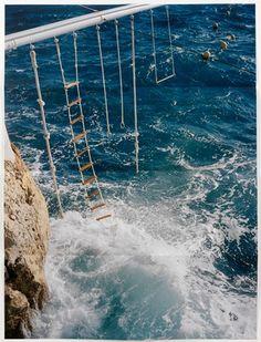 swings above the ocean in south france