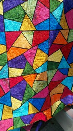 Stained glass quilt. So beautiful, but I think my eye would go bonkers. Am thinking if there is a large border that I need that this would be a wonderful idea.