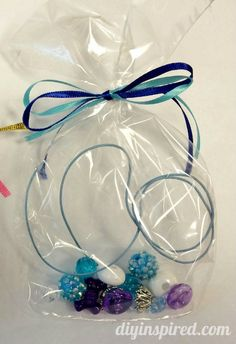 Several Frozen Birthday Party Ideas - Anna and Elsa Make Your Own Necklace Kit Party Favors