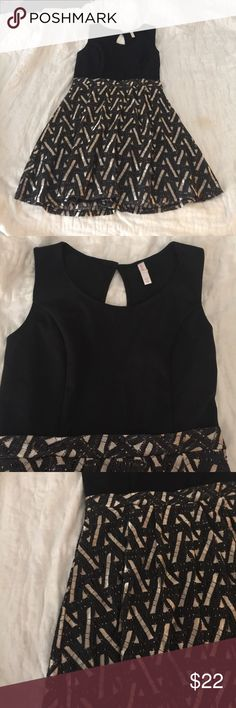 Great holiday dress in black and gold This dress was worn once. Gold and black holiday dress. Fit and flare. Scooped neck, stretch top. Side zip and keyhole back. Xhilaration Dresses