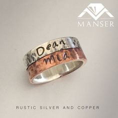 Weathered look silver and copper name ring.