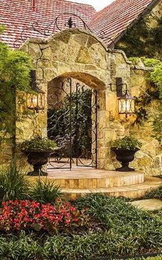 TUSCAN... Stone Entryway. Wrought Iron Gates. Great Light Fixtures!