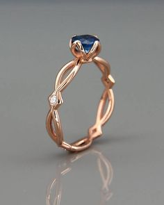 Perfection  ~Handmade solid 14K rose gold eternity engagement ring set with blue Sapphire & tiny Diamonds~  https://www.etsy.com/…/14k-rose-gold-engagement-ring-set-wi…  #EngagementRings #DiamondEngagement #GoldStatementRing #GoldBraidedRing #Enga
