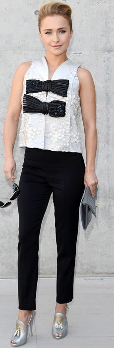Who made Hayden Panettiere's silver tassle shoes and white and black bow top that she wore in Milan? Shirt  and shoes – Giorgio Armani