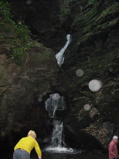 Spirit orbs caught in front of water fall at St. Nectans.
