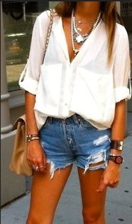 Oversized white blouse and denim shorts...........Wish I had her tan. Just once I'd love to be golden brown.