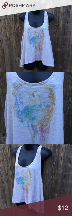 Roxy tank with wolf and dream catcher This is a pretty lavender tank with a dream catcher and wolf on the front. Almost looks like a watercolor print. Racerback. Loose fit. Brand is Roxy, size medium. Very light pilling from wash. Roxy Tops Tank Tops