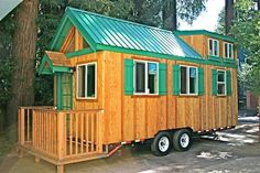 Amazing160+ sq ft trailer cabin, fully loaded, with flip-up porch. http://tinyhousetalk.com/tiny-house-flip-up-porch/