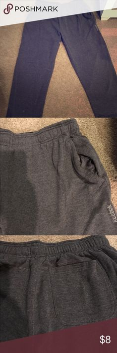 """Men's Large Reebok Dark Grey Sweatpants w/3pockets Men large reebok sweatpants. They're dark grey/charcoal with silver writing on the left hip pocket, saying """"Reebok"""". About a year old, haven't been worn in months, need space in my closet. Small hole in groin area, can be seen in 1st pic Reebok Pants Sweatpants & Joggers"""