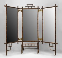 French Victorian faux bamboo 3 fold cheval mirror with open design top and bottom with brass hinges.