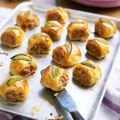 Cook a tray of these delightful sage sausage rolls to feed unexpected guests, or to serve as a delicious canapé with your Christmas Day fizz. Great to freeze. Christmas Canapes, Christmas Buffet, Christmas Party Food, Antipasto, Sausage Rolls, Snacks, Appetisers, Appetizers For Party, Sweets