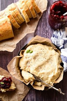 """Baked Vegan """"Goat Cheese"""" with Spiced Cranberry Spread   Tangy cashew cheese is baked to perfection and paired with a sweet + tart spiced cranberry sauce!"""