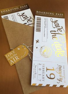 Absolutely stunning hand-foiled Boarding Pass Save the Dates. I will customize the emblem with your names and wedding date!  Two options: 1. As