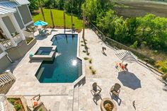 When you've the ultimate pool, beach and fire pit in your backyard, there's really no reason to leave! Swimming Pool Designs, Swimming Pools, Inset Cabinets, Gray Cabinets, Grey Backsplash, Blue Pool, Luxury Pools, Pool Builders, Spa Services