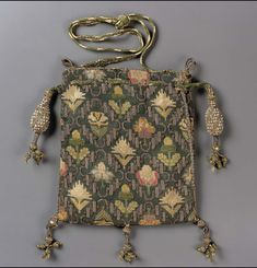 Drawstring bag | England | early 17th century | Linen plain weave embroidered with silk, gold metallic threads, seed pearls Braided silk and metallic cords and tassels | Museum of Fine Arts, Boston | Accession #: 38.1344