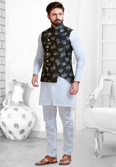 Linen Kurta in Off White This Readymade attire is Enhanced with Buttons and is Crafted in Chinese Collar Neck and Full Sleeve Available with a Linen Churidar in Off White and an Art Silk Jacquard Asymmetric Nehru Jacket in Black Do note: Footwear shown in the image is for presentation purposes only. Half to one inch may vary in measurement. (Slight variation in actual color vs. image is possible)