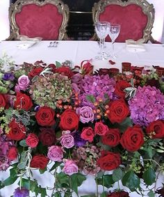 Part of a Sumptious wedding by Paula Pryke Floral Artist at Bevoir Castle
