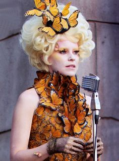 get on the hunger games halloween costume this year by dressing up as effie trinket a blonde wig and some colorful eye makeup can go a long way w