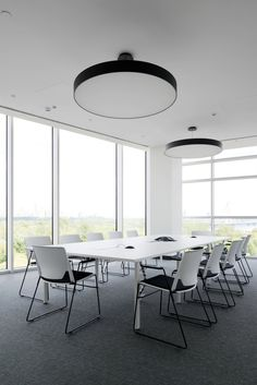 Adidas Offices – Moscow. ABD Architects. Meeting Room. Feature Pendant. Black and white. Neutral. Meeting table.