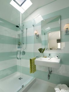 Glossy Striped Walls in clean-lined bathroom with skylight and glass shower - The Carriage House by Butler Armsden Architects