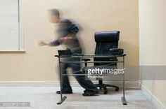 man-moving-from-behind-table-in-empty-office-blurred-motion-picture-id200309127-001 (507×337)