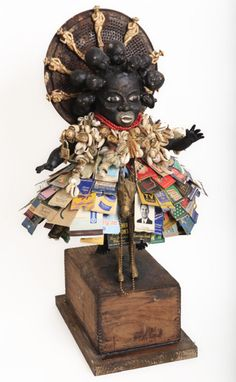 Vanessa German: true grit; found dovetail wood box, found vintage metal horse, found kitchen stainer, vintage matchbook covers, beads, old broken German doll heads, Jim Beam whiskey stirrers, buttons, beads, keys, hardware, doll parts, cowrie shells, wood and plaster, 23 x 13 x 12 inches, 2011