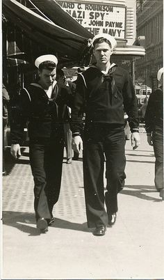 #vintage #sailors #1940s Photographers would set up and take pictures of you walking down the side walk. My grandparents had a few of these old photos taken.