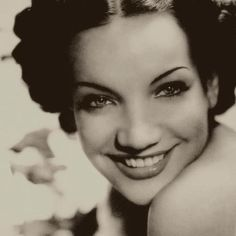"Carmen Miranda, was a Portuguese-born Brazilian samba singer, dancer, Broadway actress, and film star who was popular in the 1940s and 1950s. She made her American stage debut in July 1939, and later moved to Hollywood to pursue a film career. Nicknamed ""The Brazilian Bombshell"", Miranda was noted for her signature fruit hat outfit she wore in the 1943 movie The Gang's All Here. By 1945, she was the highest paid woman in the United States."