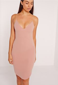 Damn girl, nice dress! A dress doesn't have to be covered in embellishment or pattern to be killer. This basic evening dress will look like you've dropped serious dollar. In a dark nude hue, delicate rouleau straps, v neckline and bodycon f...