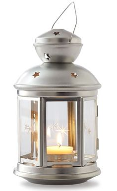Made from galvanized steel and glass, this star-studded lantern can accommodate tea lights or LED—perfect when the party is still kickin' after sundown. | Rotera lantern, about $4 from IKEA