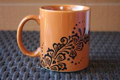 Orange and Black 10oz Coffee Mug with Floral Henna by ibleedheART
