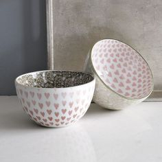 "Heart bowls, West Elm       • Porcelain.    • Reverse print in Pink / Espresso.    • 5""diam. x 2.75""h.    • Microwave and dishwasher safe.    • Made in Ja"