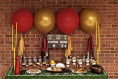 awesome example of a superbowl birthday party. using red and gold colors, create a festive birthday celebration. Use the balloons and decorate it with paper tassels! #birthday #decor