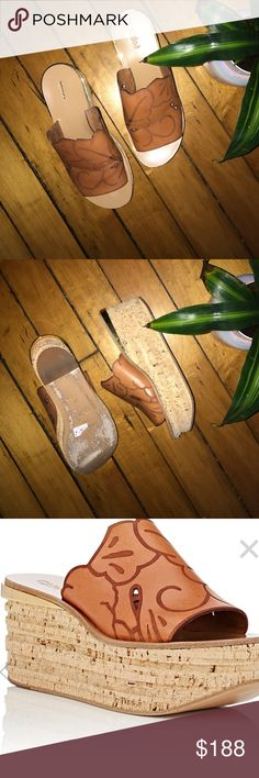 Chloe Camille wedge mules. 39. Crafted of light brown calfskin laser-cut in a floral pattern, Chloé's Camille mules are inset at stacked cork wedge heel with a goldtone plate. Labeled as a 39, but I think would fit an 8.5 best. Gently worn. Chloe Shoes Mules & Clogs