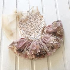 Beautiful mini lace dress with attached textil flowers, vintage touch. The top of the dress is made from soft tulle and streatchy lace, pink powder color, and the attach skirt has fabric flowers. The lenght of the dress : ballerina dress
