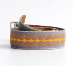 Gray Orange Belt. This handmade belt is the perfect colorful accessory! It is made by artisans in the rural and most needed areas of Guatemala, using the backstrap loom traditional technique.