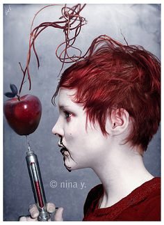 Another dramatic picture. Like how they matched the color of the hair and applemakeup and shirt, adds to unity. Needle shows how nature is being manipulted and the effect it has on us