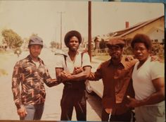 Raymond Lee Washington (2nd from right), spreading love with the homeboys. (Photo: '70s) #westside #crip