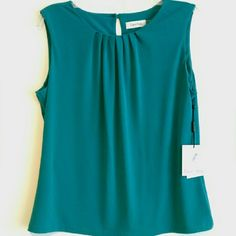 "NWT! Teal Calvin Klein tank, size L Reposh NWT! Teal Calvin Klein tank, size L. This was too short for my long torso, measures 24"" from shoulder to hem. No flaws, no snags, no holes, comes with extra button for the back closure Calvin Klein Tops Tank Tops"